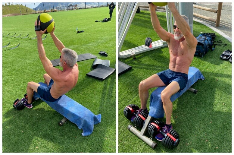Man doing crunches with medicine ball.