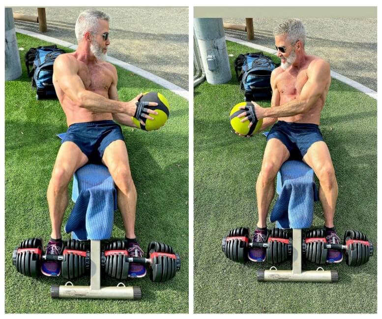 54-year old man trains abdominals with medicine ball.