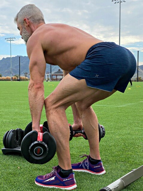 This exercise combines dumbbell squat with a good morning exercise.