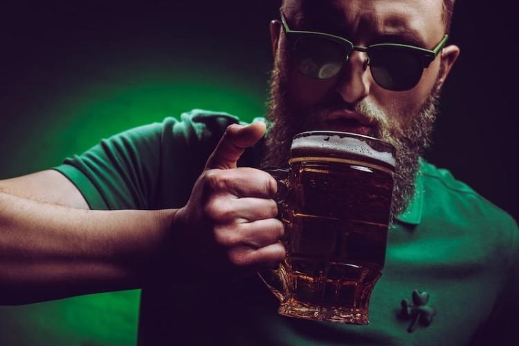 man drinking Guinness properly