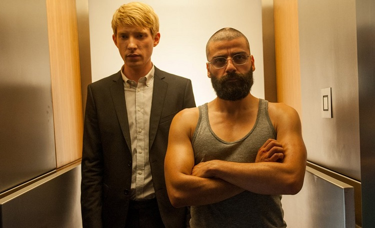 A terrified Domhnall Gleeson and a buff Oscar Issac get ready to do some science.