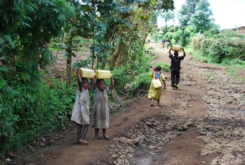Rwanda-girls-carrying-water-on-road.jpg