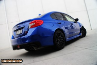 While the massive wing is now a (no cost) option, the STi's monstrously mental approach to destroying corners is still very much intact. It still very much has a tendency to understeer if you go in too fast, but with all that fat torque on tap, the good ol' slow-in-fast-out approach works just fine, thank you very much!