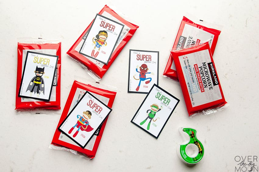 Taping the Sock Monkey printable Valentine to bags of popcorn! From overthebigmoon.com!