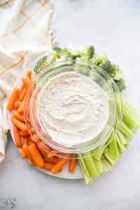 This Vegetable Dip is the perfect side dish or appetizer! From overthebigmoon.com!