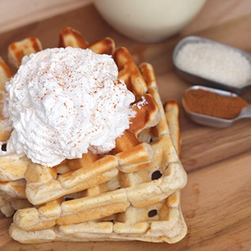 These Eggnog Waffles with Sweet Cinnamon Whipped Cream Waffles are the perfect Winter breakfast! The eggnog taste is there, but subtle and not overwhelming! And the Sweet Cinnamon Whipped Cream is the perfect topping!