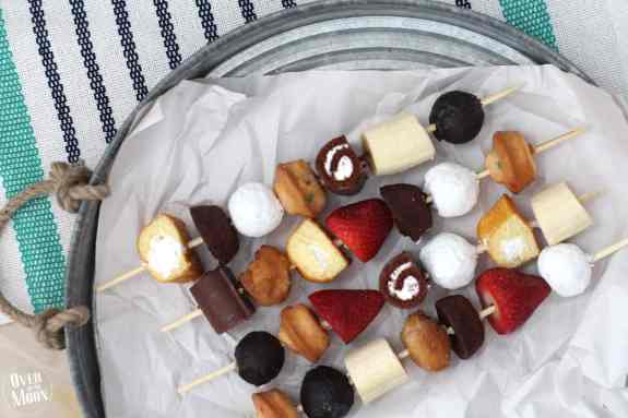 These are awesome! No baking required - just buy desserts and put them on kabob sticks and serve! Plus, the kids love helping assemble them! From www.overthebigmoon.com!
