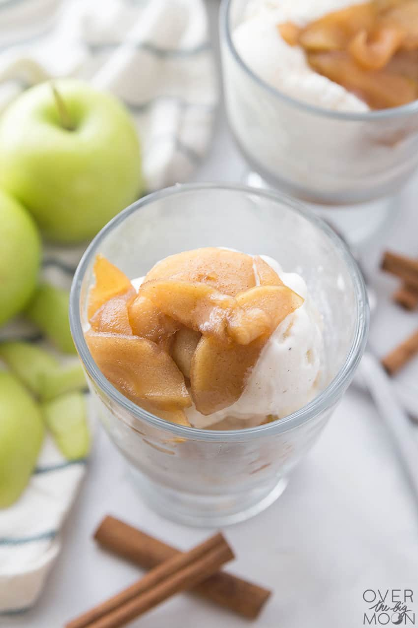 Cooked Cinnamon Apples on top of vanilla ice-cream! The perfect Fall treat! From overthebigmoon.com!