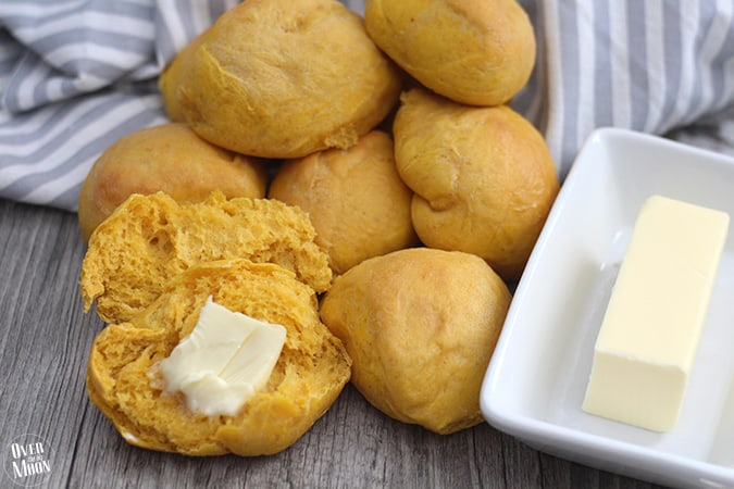 These Pumpkin Dinner Rolls are such a fun addition to any meal. The pumpkin flavor is not overwhelming! From www.overthebigmoon.com!