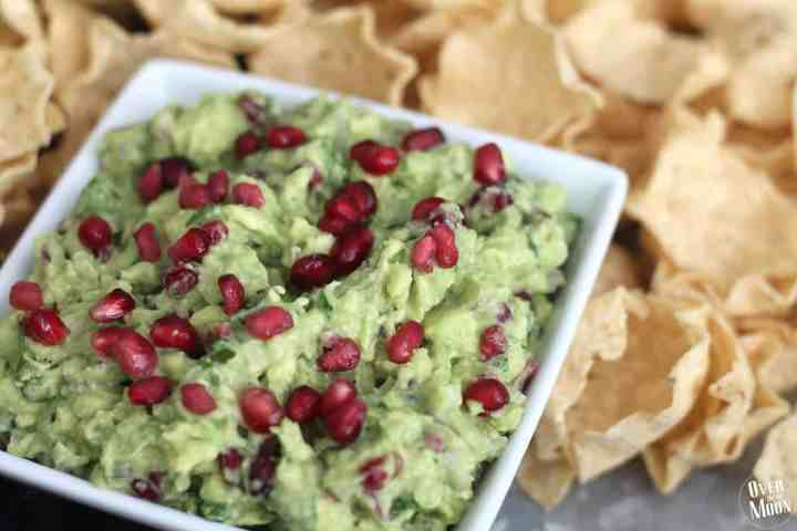 This Pomegranate Guacamole is such a fun change from a traditional guacamole! Especially during the holidays! Check it out! Recipe at www.overthebigmoon.com!
