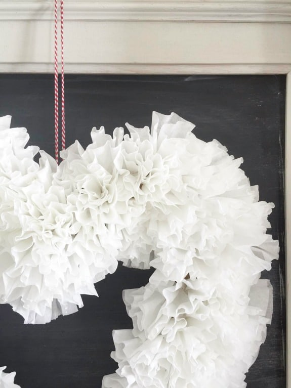 This DIY coffee filter Valentines wreath is so sweet, and so easy!