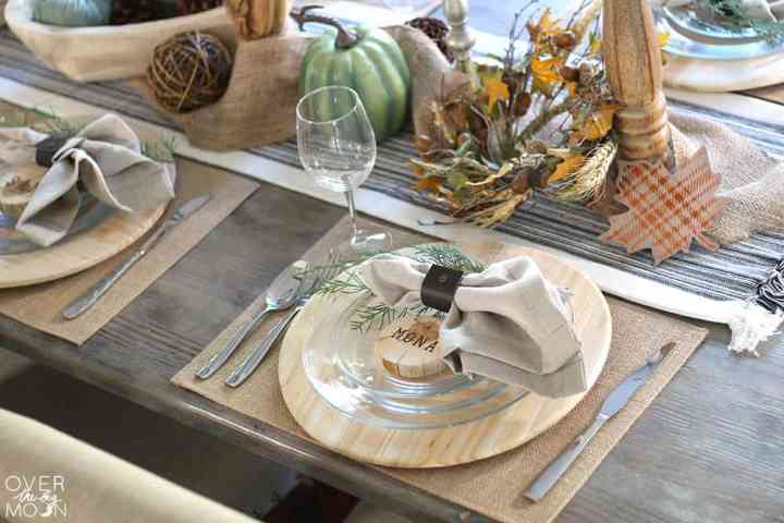 Elegant Neutral Thanksgiving Table - the natural wood elements pair with the greens are the perfect combination! From www.overthebigmoon.com!