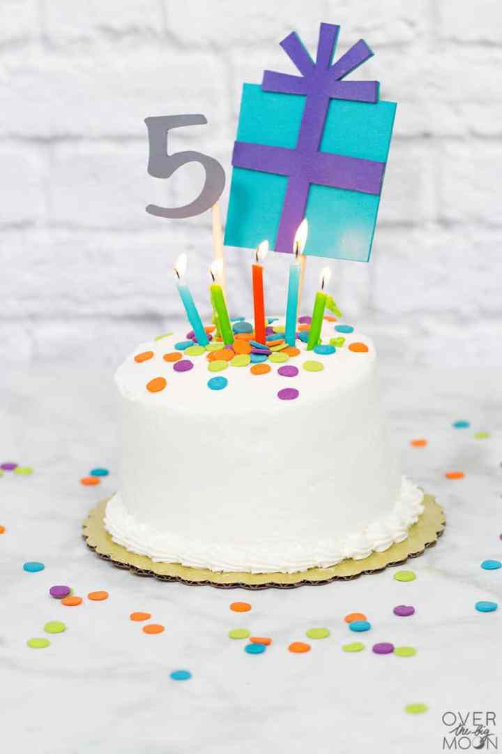 White cake with a colorful birthday cake topper made from Chipboard.
