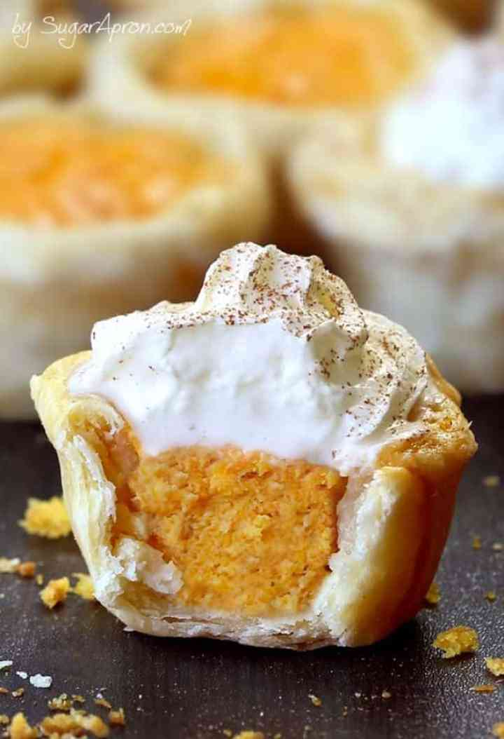 A Pumpkin Pie bite, showing the inside filling. Topped with whip cream!