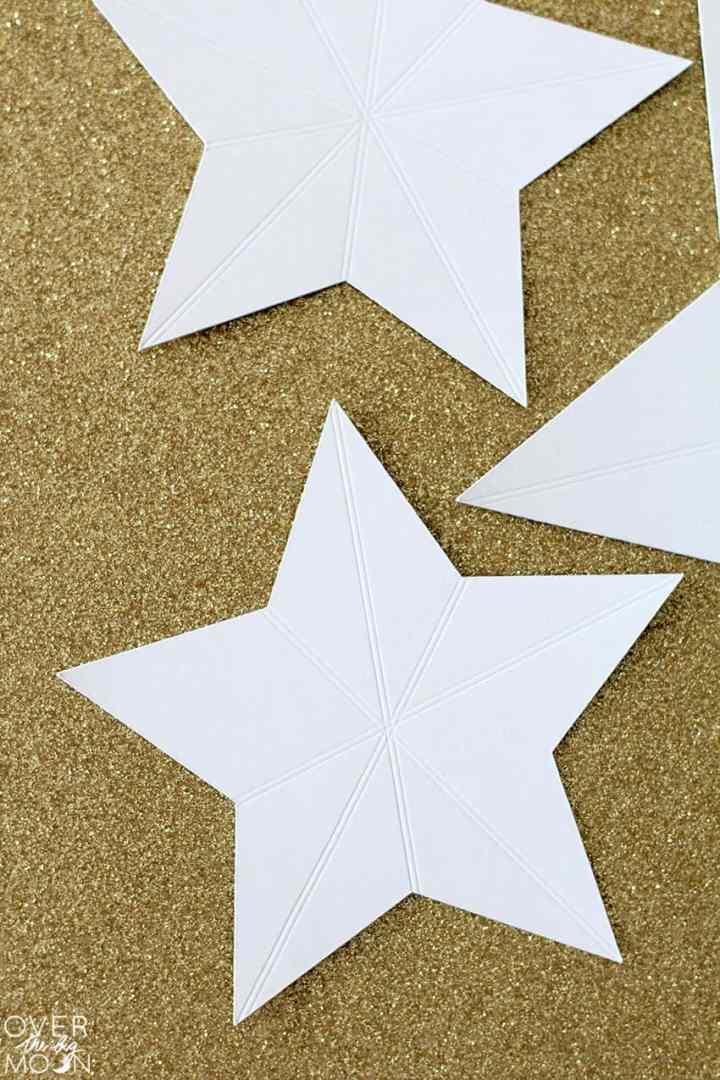Scoring Lines in Glitter Cardstock using the Scoring Wheel from overthebigmoon.com!