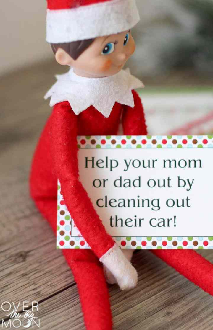 """Elf on the Shelf holding a Good Dead Card saying, """"Help your mom or dad out by cleaning their car!"""""""