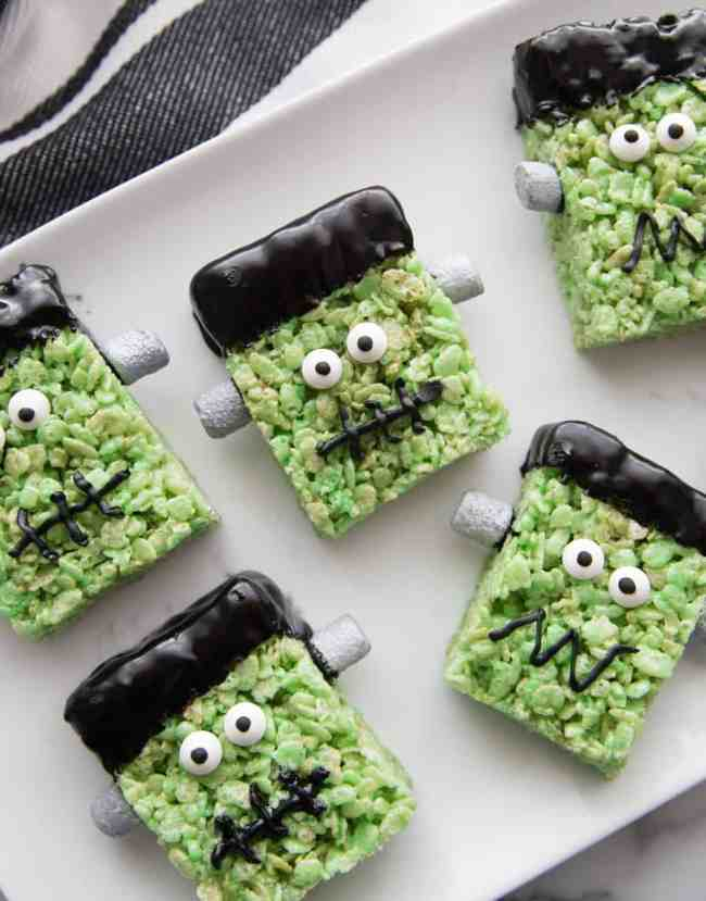 Green Rice Krispy treats made to look like Frankenstein Monsters.