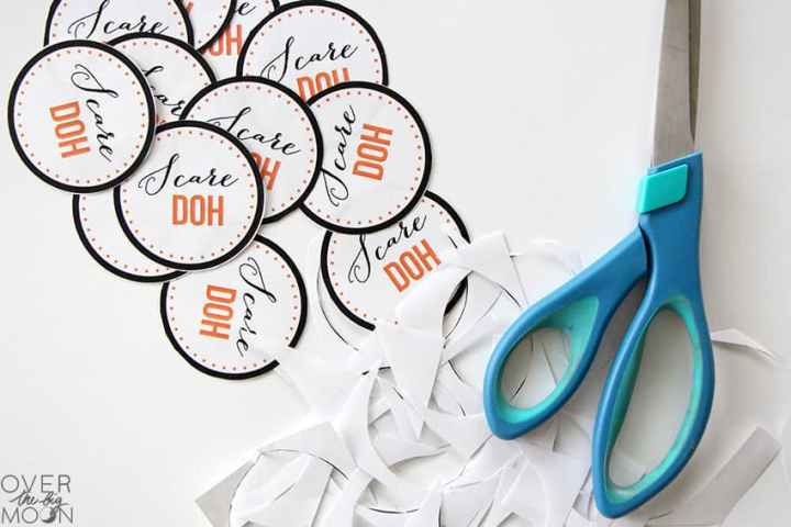 Scare Doh Printable Tags cut out with a pair of scissors and paper scraps.