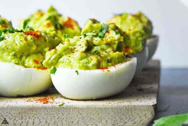 Avocado Deviled Eggs on a cutting board!