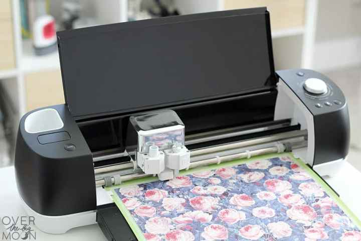 Floral Infusible Ink being cut on a black Cricut Explore Air 2.