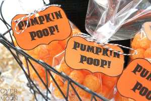 3 Bags of cheese balls in baggies, with printable tags on them that say Pumpkin Poop.