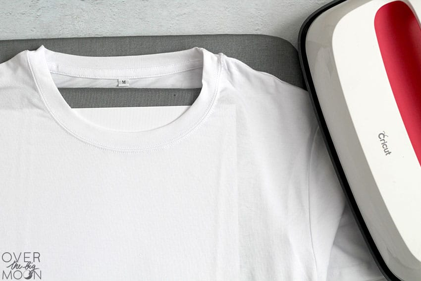 A white shirt, with a EasyPress mat and piece of cardstock in it, ready to have a design applied with the EasyPress.