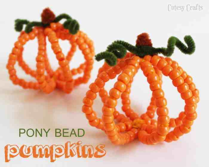 Pumpkin crafts made from pipe cleaners and pony beads.