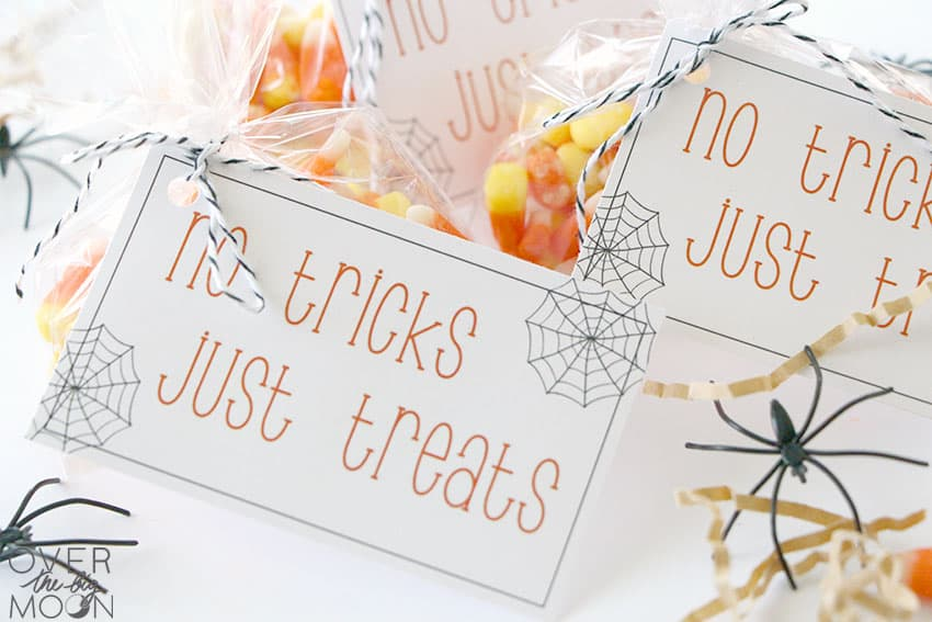 Candy corn in a bag, with a gift tag that says No Tricks, Just Treats on it.