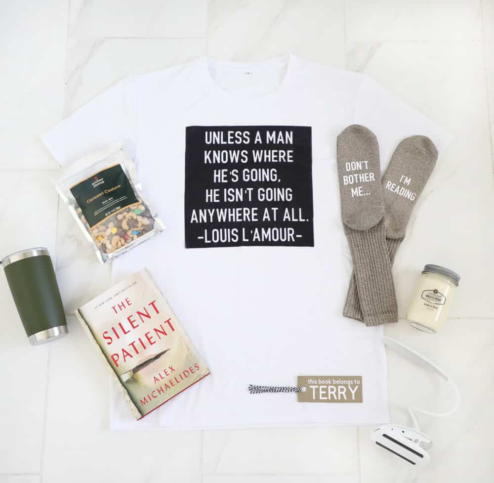 Shirt, book, bookmark, socks and more laid out in a picture, showing what would be put in book lovers gift basket!
