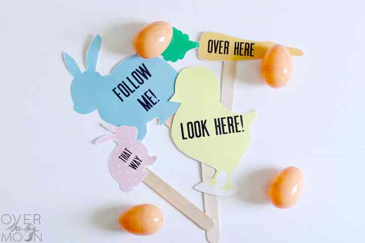 4 Printed Easter Egg Hunt Signs that are printed and on sticks. A pink bunny, blue bunny, yellow chick and orange carrot.
