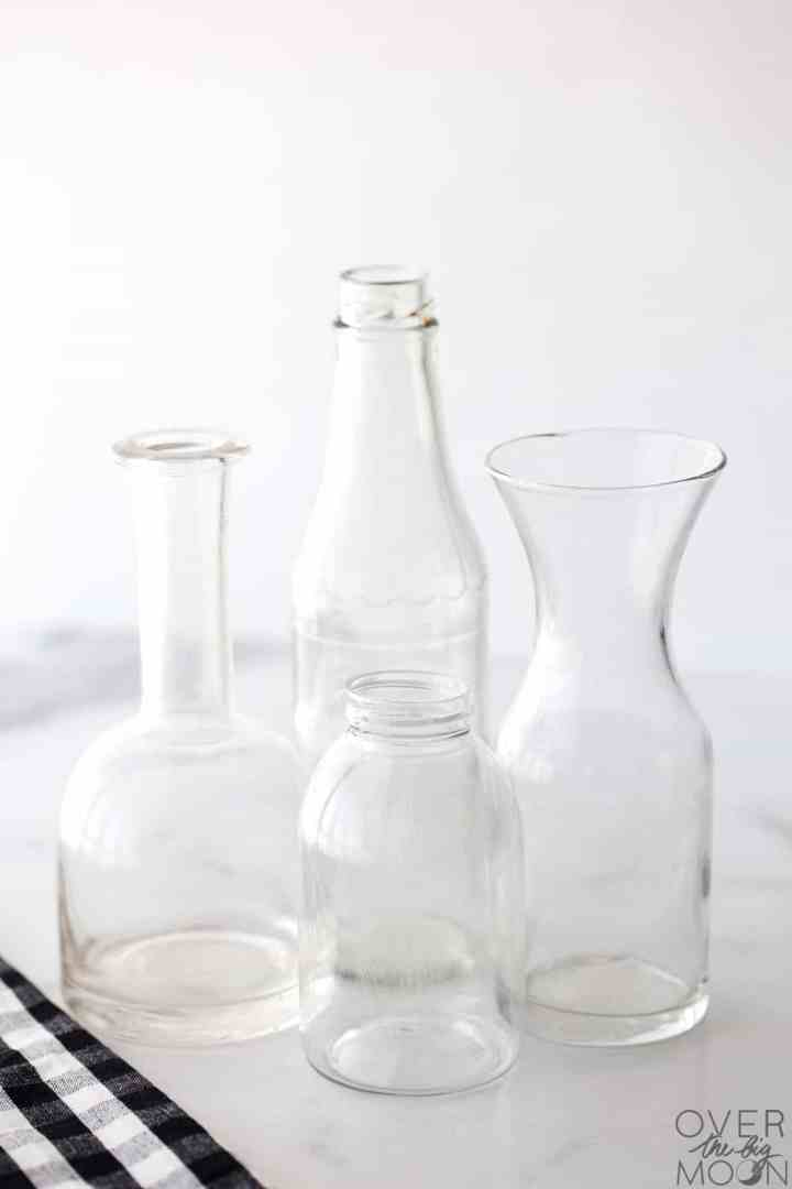 4 new glass bottles in all different shapes and sizes.