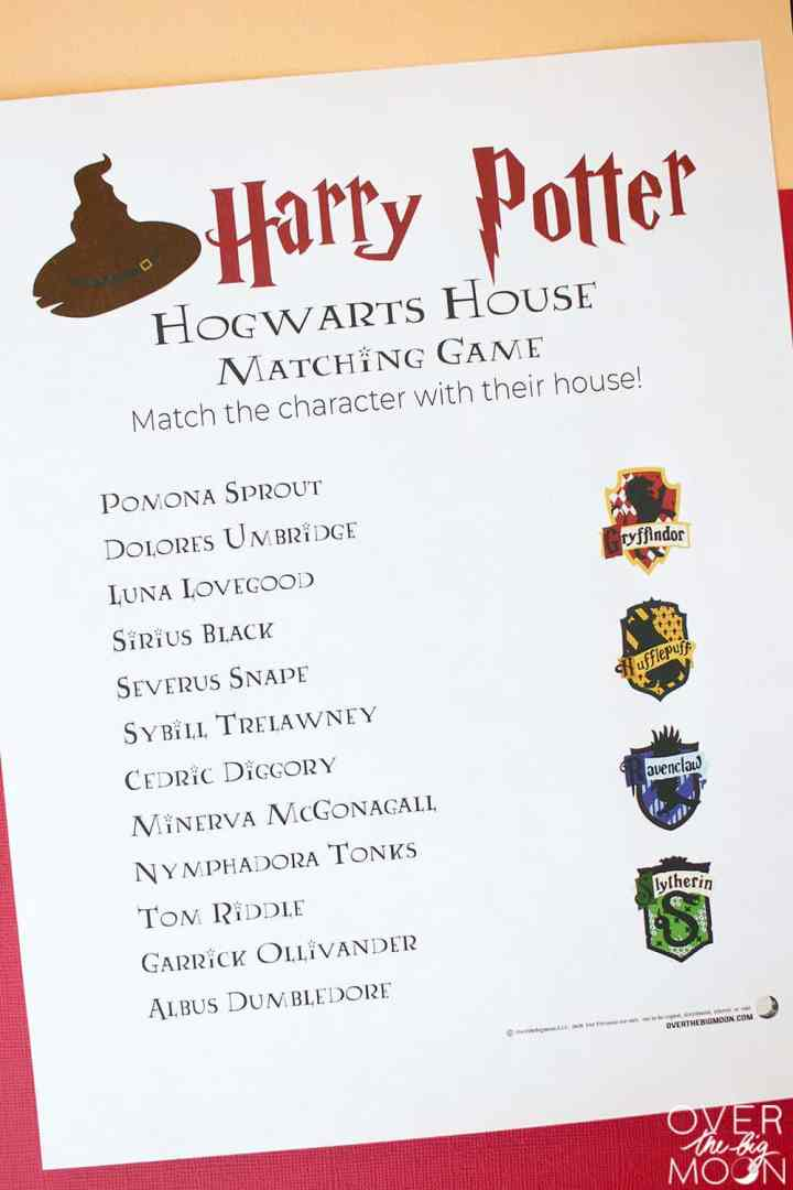 A Harry Potter House Matching Printable Game on a table with red and yellow backdrop.