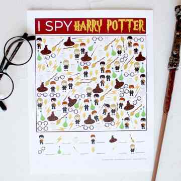 The printable Game I Spy Harry Potter on a white backdrop with Harry Potter glasses and a wand next to it.