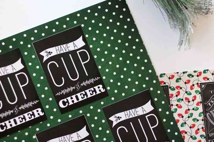 Printed chalkboard Christams printables spread out on a green scrapbook paper.