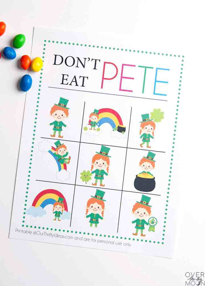 A printed sheet with the game Don't Eat Pete with a St. Patrick's Day theme. The squares of Leprechauns and Rainbows on them.