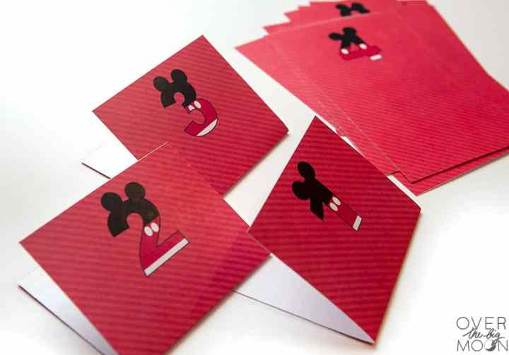 Folded red printable cards with numbers on them.