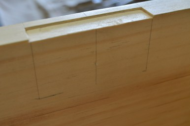Laying out the mortises for the lock. The top plate mortise has been cut here.