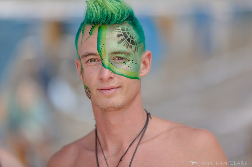 burning-man-2013-cargo-cult-black-rock-city-playa-jonathan-clark-man-with-green-facepaint-centercamp