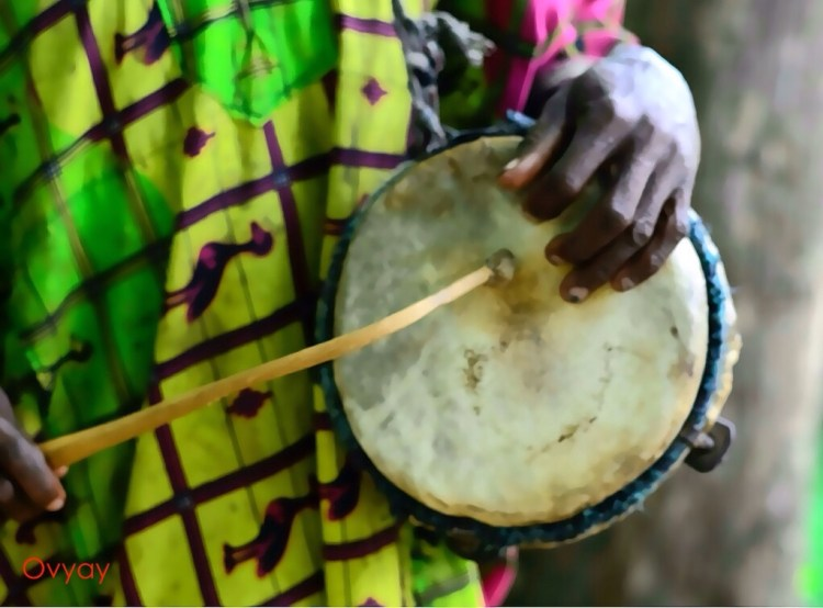 Talking drum being played by Baba Jegede at Erin Jesa Waterfalls