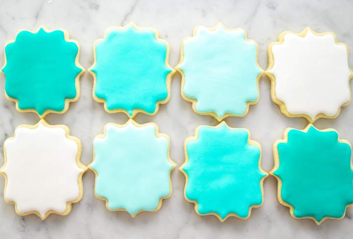 No Chill Sugar Cookie Cut Outs- decorated cookies in a row flatlay