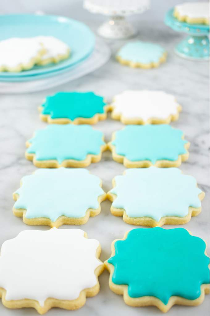 No Chill Sugar Cookie Cut Outs- decorated cookies in rows