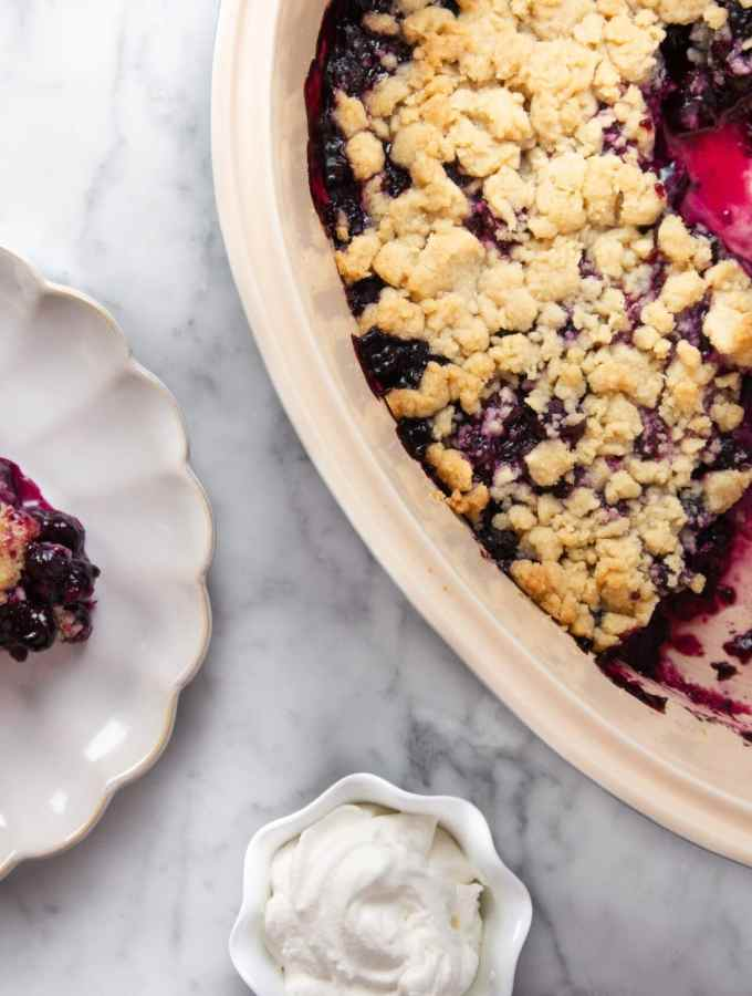 Blueberry Crisp flatlay with a side of whipped cream