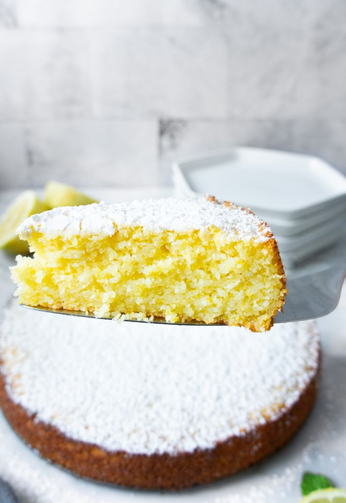 Slice of Lemon Ricotta cake on cake server