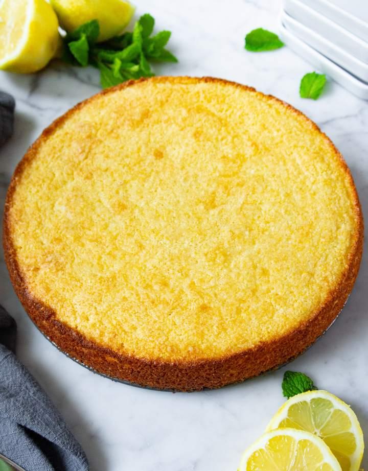 Lemon ricotta cake unsliced without powdered sugar, vertical photo