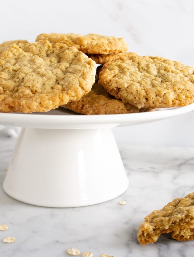 Oatmeal Cookies stacked on a white cake stand