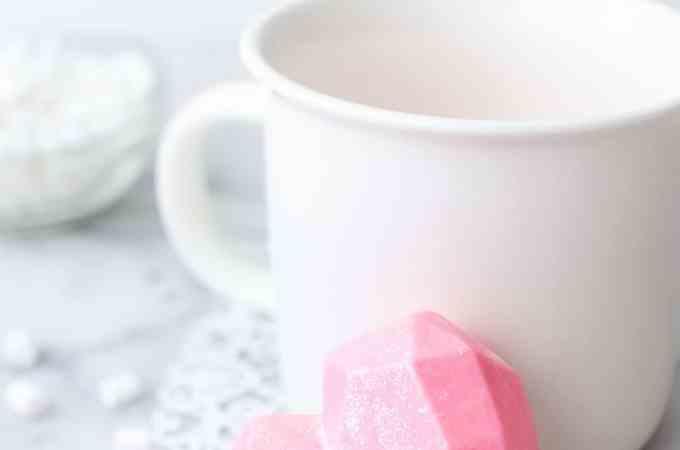 valentines day hot chocolate bombs near a white mug