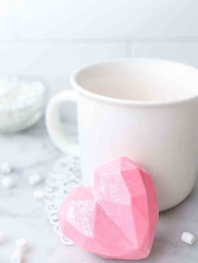 valentines day hot chocolate bombs near a white mug