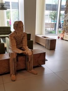 Iceland hotel wooden statue man sitting