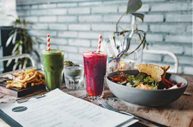 delicious lunch with salad french fries and smoothies