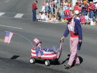 kid in wagon at parade
